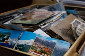 A box full of photographs and sentimental objects.
