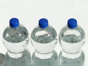 Three bottled waters.
