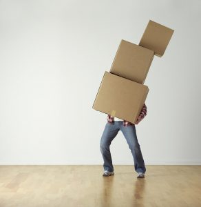 Man moving boxes. - pack and organize your storage unit