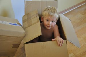 A boy inside moving boxes Ontario.
