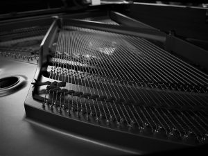 An inside of a piano