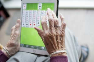 an elderly woman playing a game