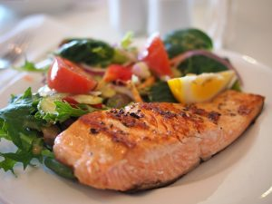Salmon and vegetables on the plate.