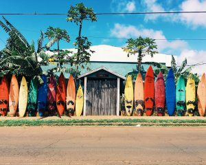 Colorful surfboards neatly stacked, reminding one of Hawaii