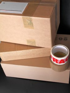 Inspect moving boxes before labeling them.