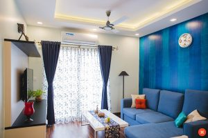 A small living room with blue decorations