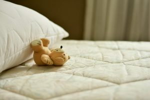 Mattress, pillow and teddy bear