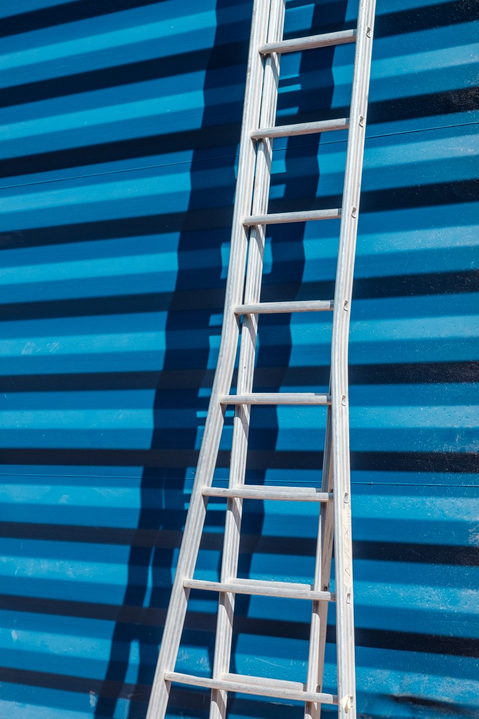 One of the storage container pods, blue with ladder