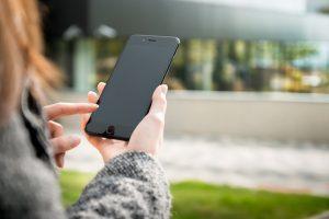 Women holding smartphone