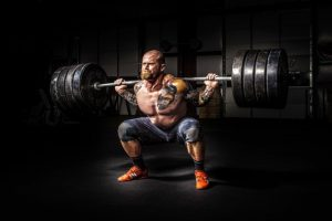 A professional heavy lifter lifting weights