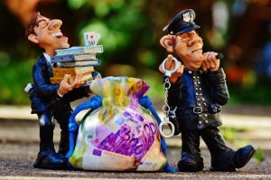 Figurines of a police officer and a thief