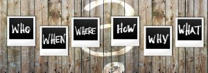 Words where, how, when etc on wood board with question mark