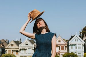 A woman in a summer dress and a nice hat