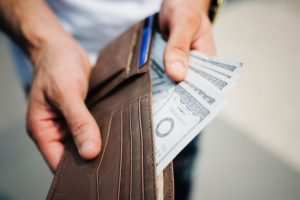 A man taking money out of his wallet