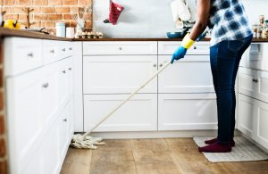 A woman cleaning her kitchen