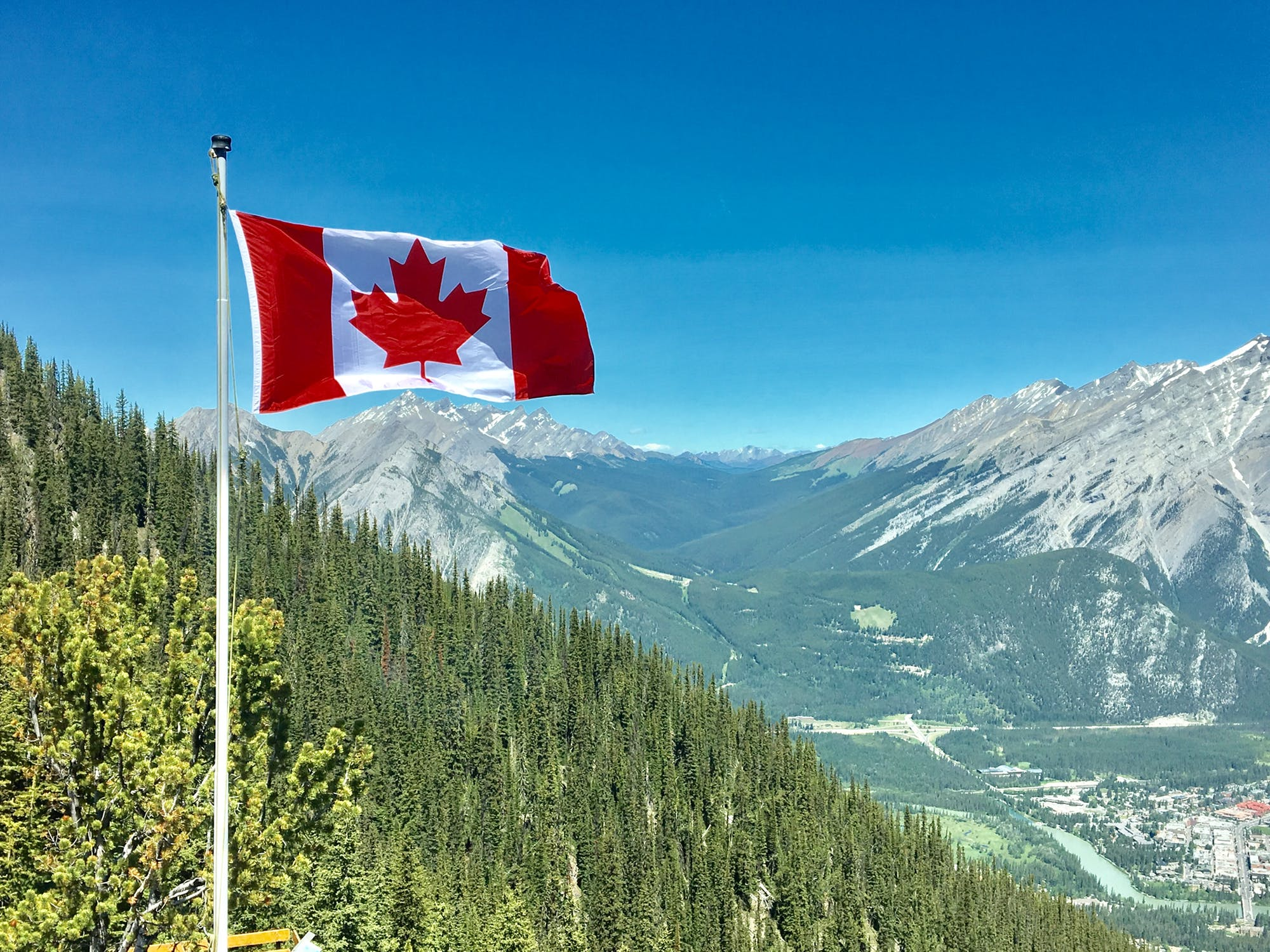 canada flag with mountain in the background