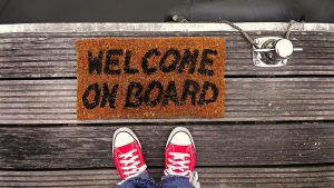 A welcoming mat that says 'welcome on board'