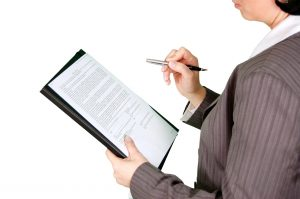 A woman looking at a document