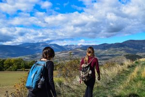 Two girls walking on a trail, which is one of the best outdoor activities in Hamilton.