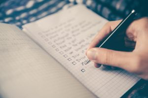 Hand writing a checklist