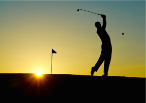 An image of a golf player during the sunset