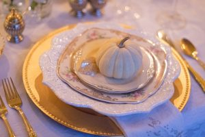 White pumpkin on a fancy plate setting in Hamilton this Thanksgiving