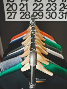 multi colored shirts hanging on a clothes rack