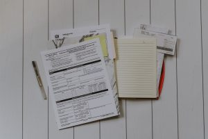 paperwork on a table after moving to Ontario with a newborn