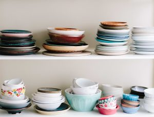 plates and bowls stored on shelves