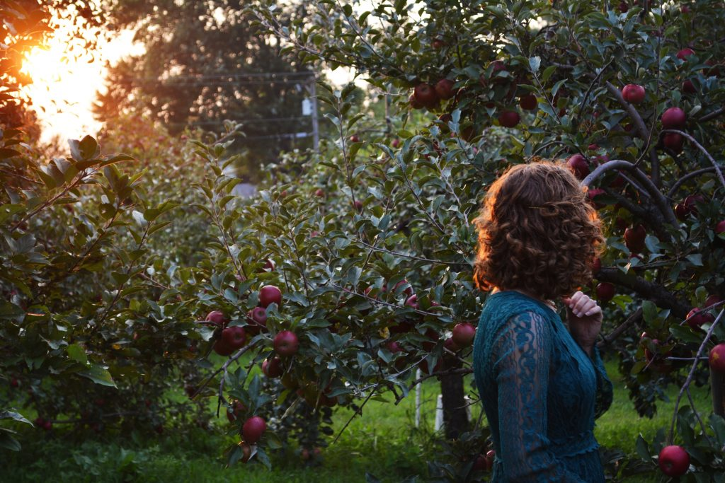 woman in an orchard exploring top things to do in Ancaster