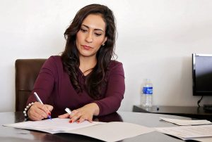 A woman making a working plan before moving to Brantford