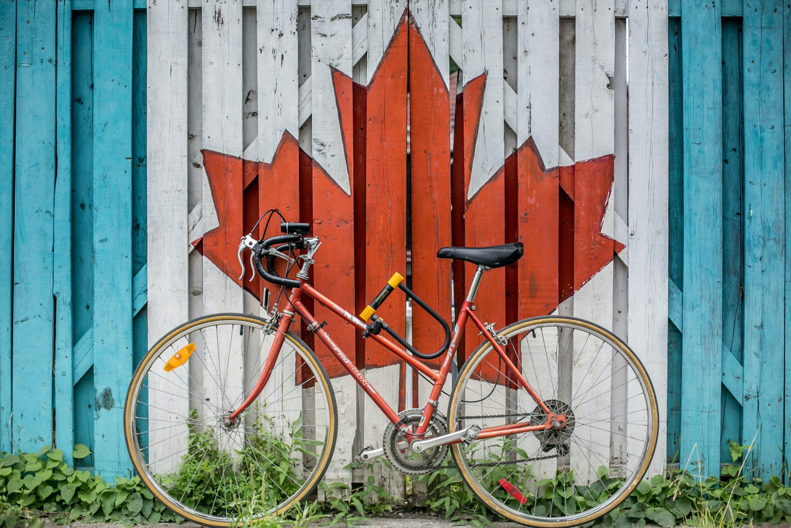 bike resting on a fence