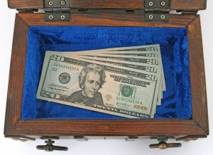 dollar bills in a box