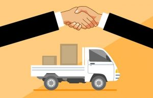 Handshake in front of a moving truck