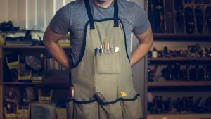 A photo of man wearing an apron