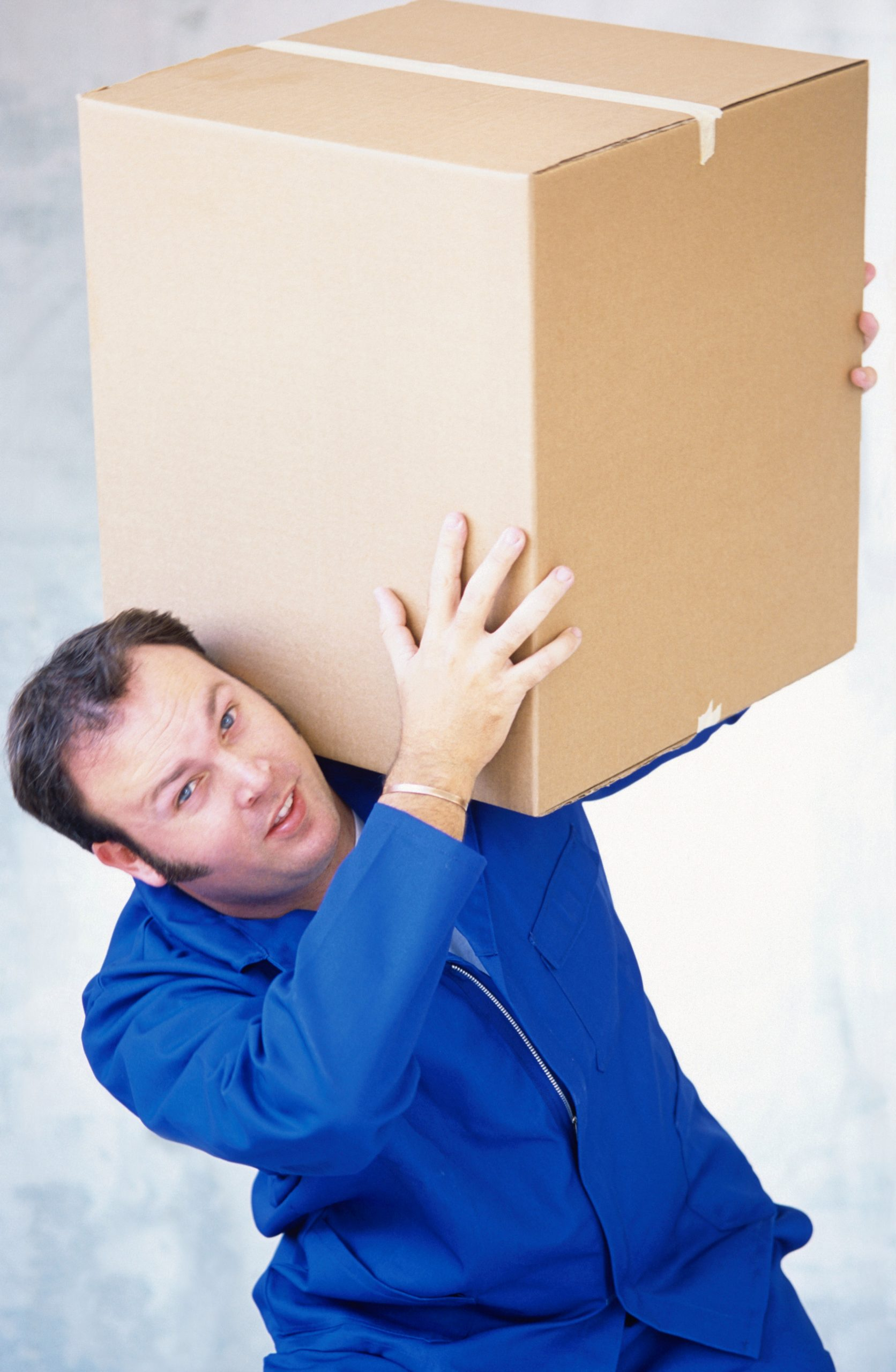a man holding a box