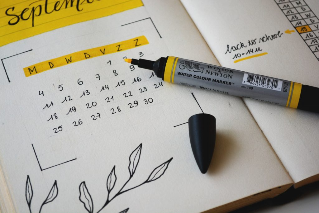 a calendar in a notebook