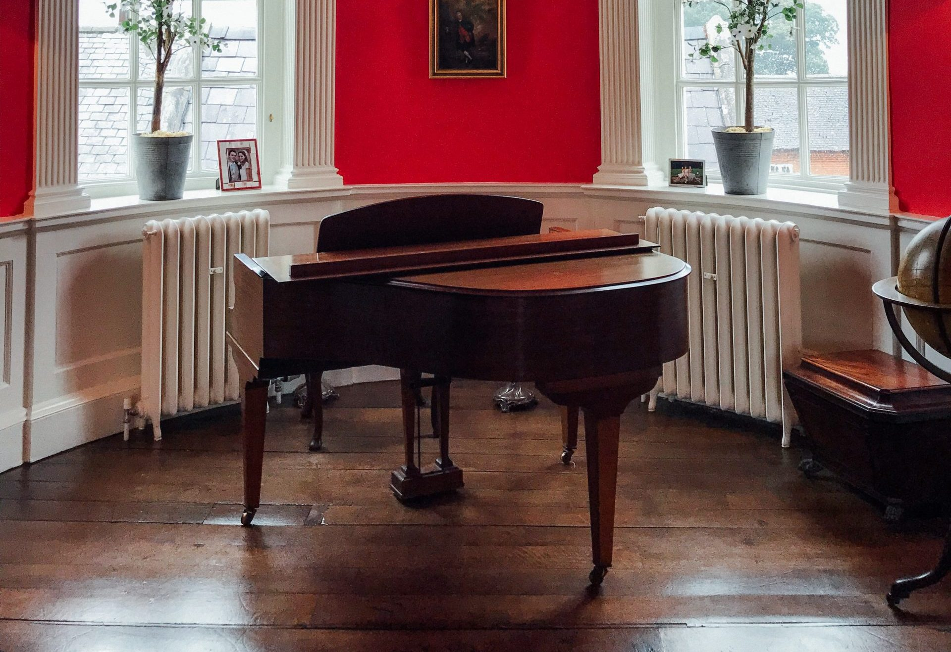brown piano in a red room