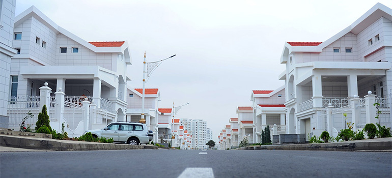 A nice looking neighborhood with white houses where New Brunswick movers could move you to