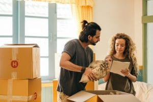 A couple that is following our room-by-room packing guidelines
