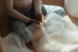 Girl holding bubble wrap