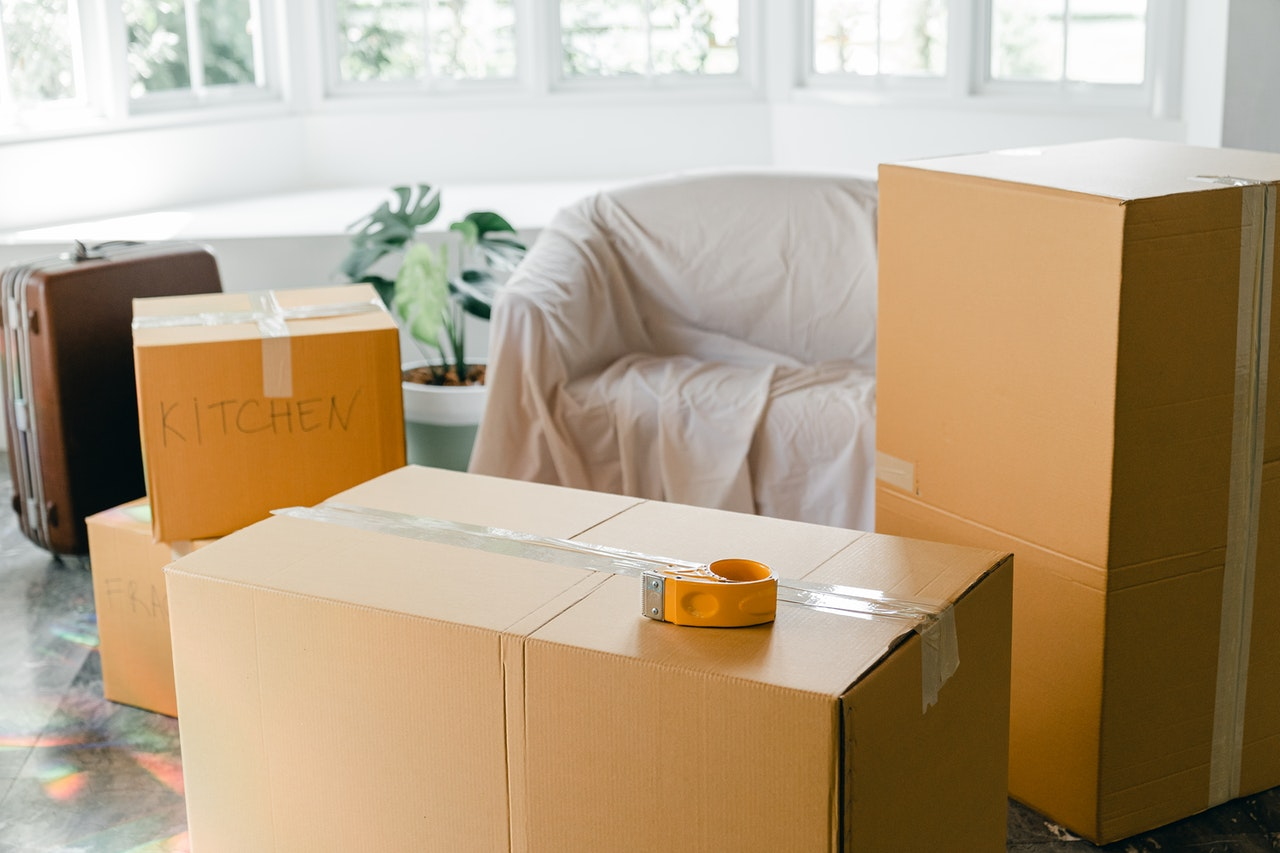 A couch and cardboard boxes