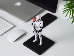 A storm trooper figurine on the desk