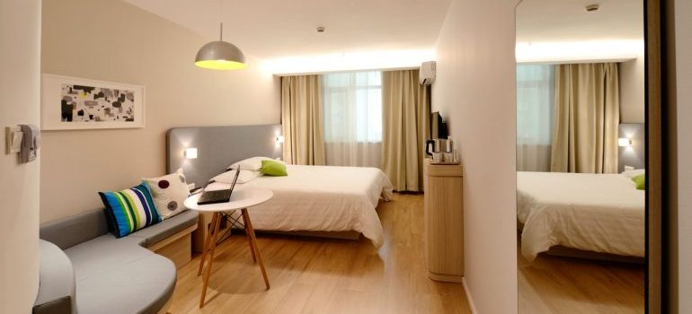 A cozy hotel room is a good choice when moving into temporary housing.