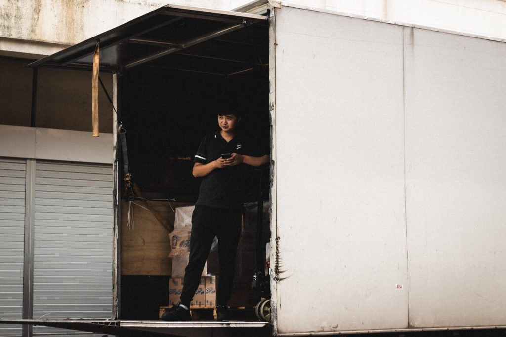 Man standing in a truck