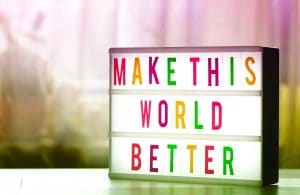 sign that says make thins world better