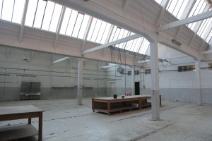 empty warehouse showcasing the benefits of storing furniture during a move
