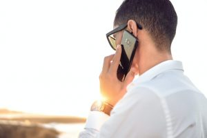 a man talking on the phone - report a moving scam in Toronto