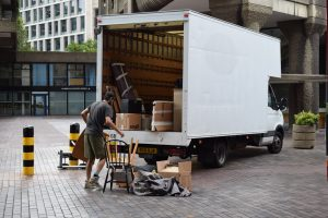 man packing items in moving truck