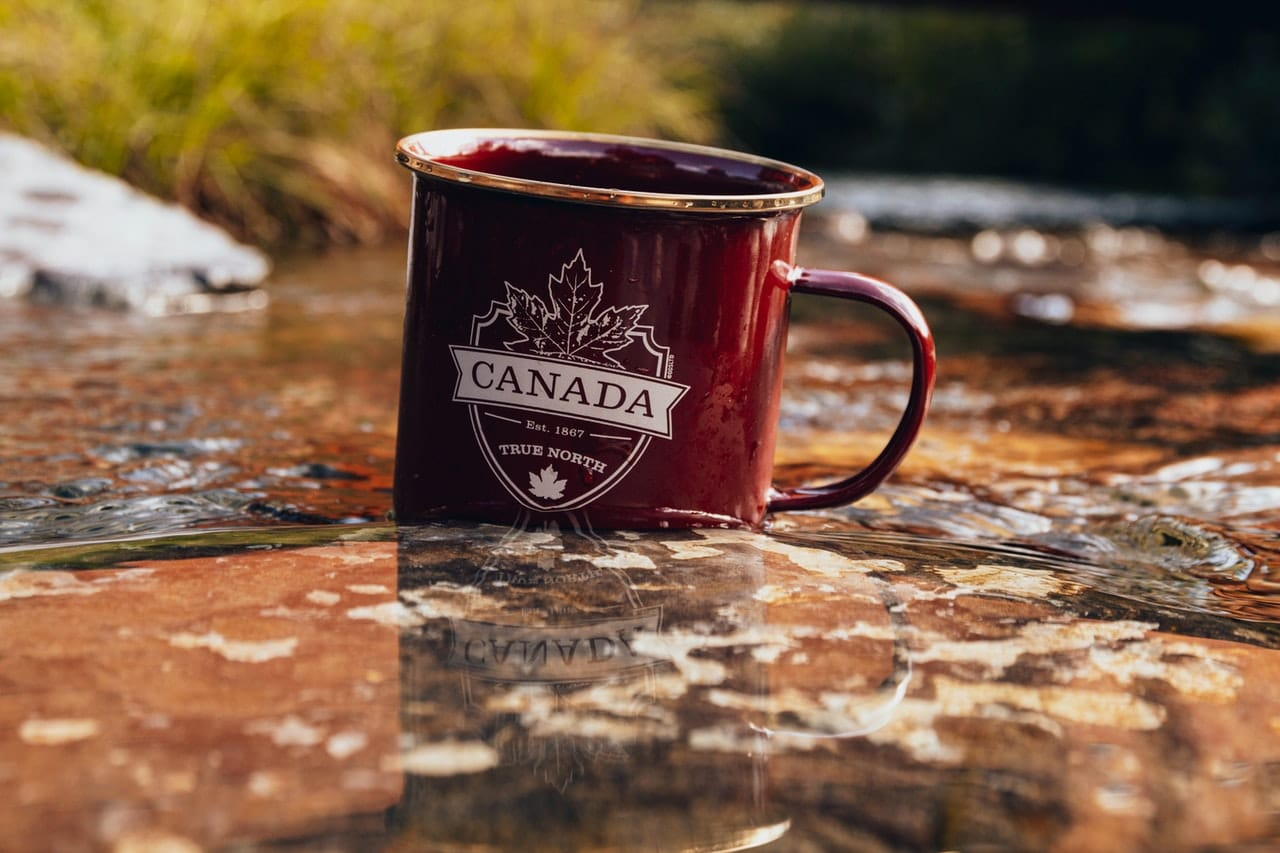-A cup in the water with Canada sign